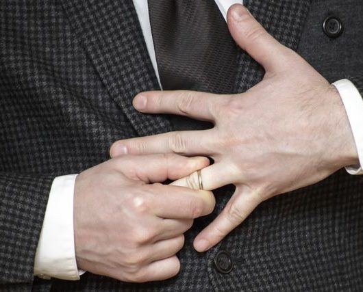 man removing ring