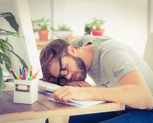 man sleeping on desk