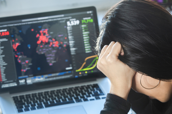 a woman looking at the statistics during lockdown